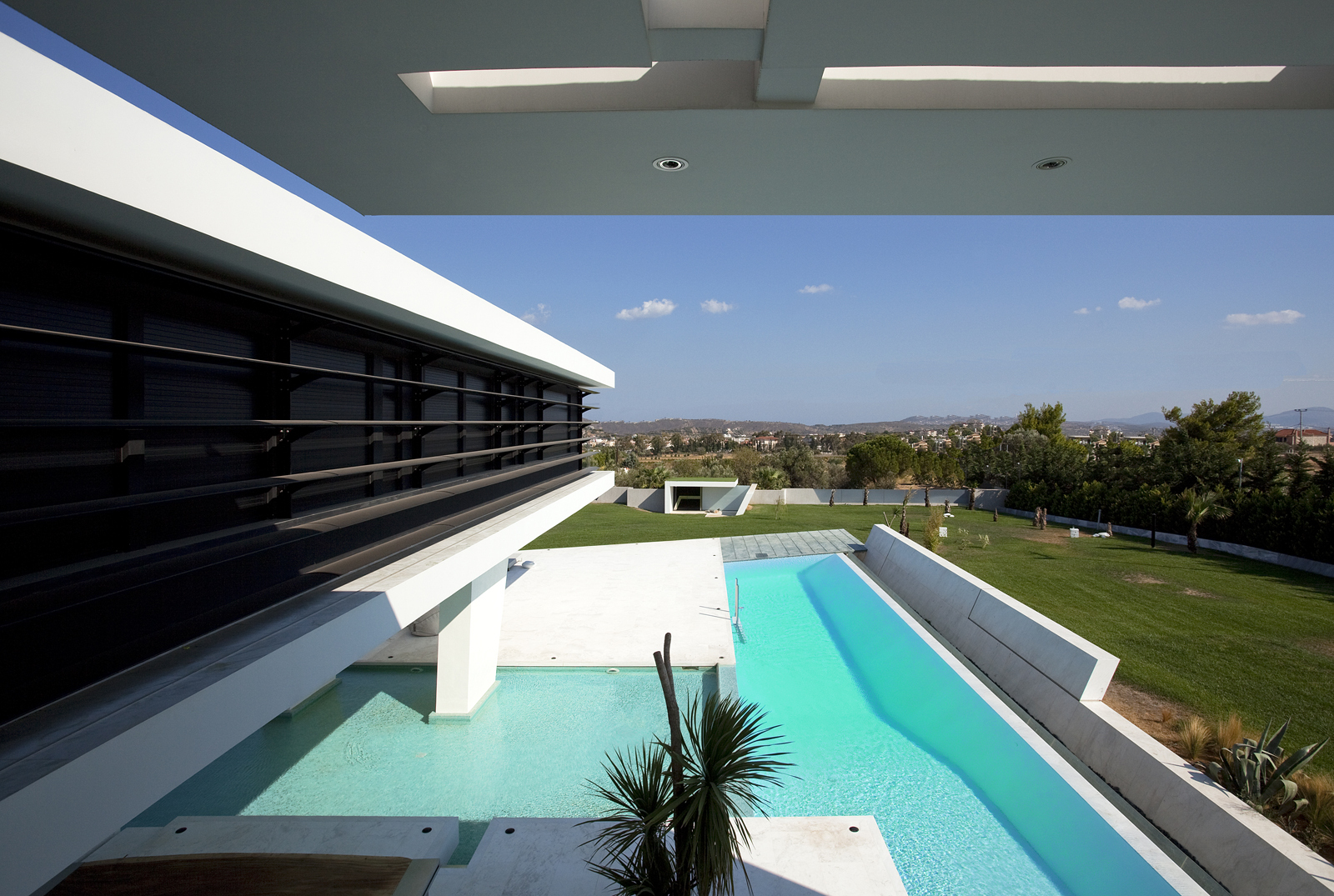 Swimming pool from an impressive ultra modern house in athens