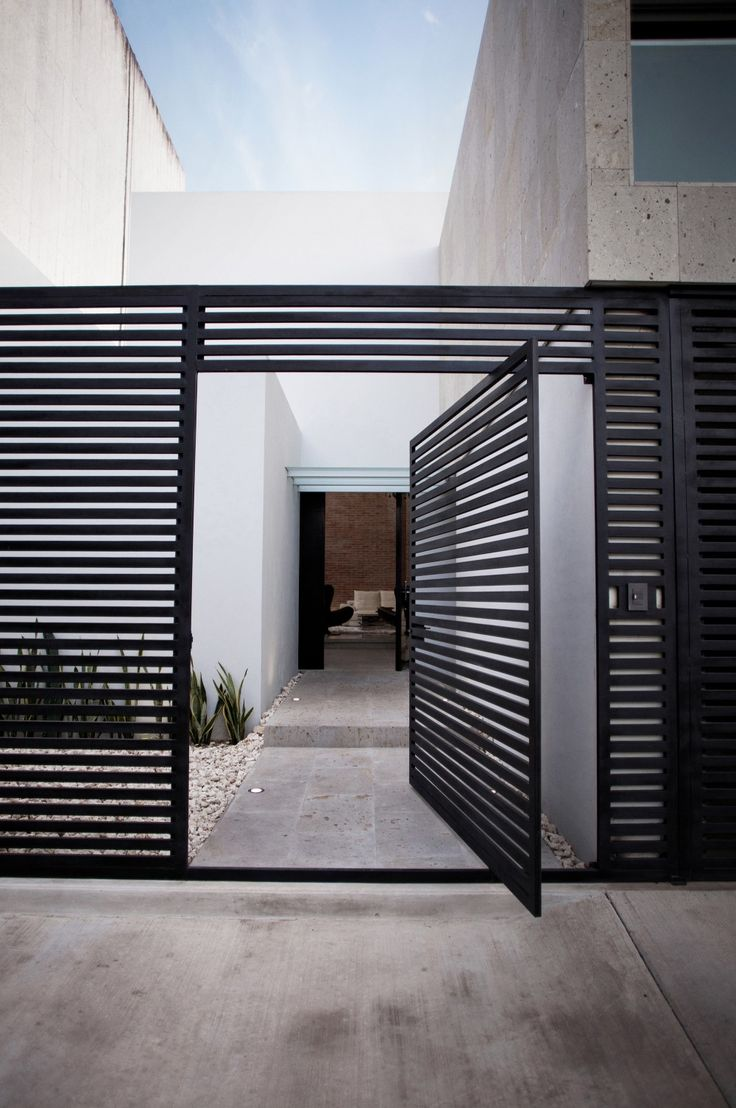 40 modern entrances designed to impress architecture beast for Modern house gate designs