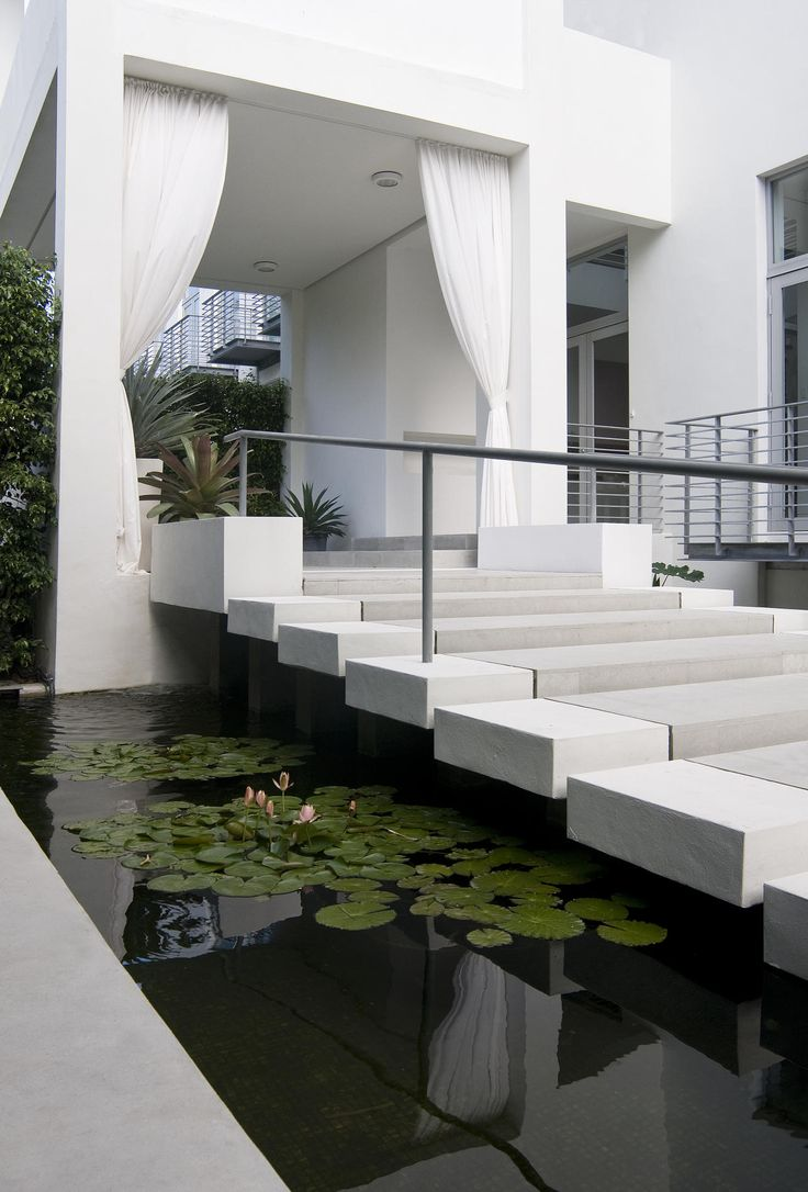 40 modern entrances designed to impress architecture beast for Modern koi pond design