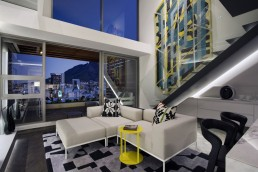 White sofa in small apartment by SAOTA, De Waterkant, Cape Town