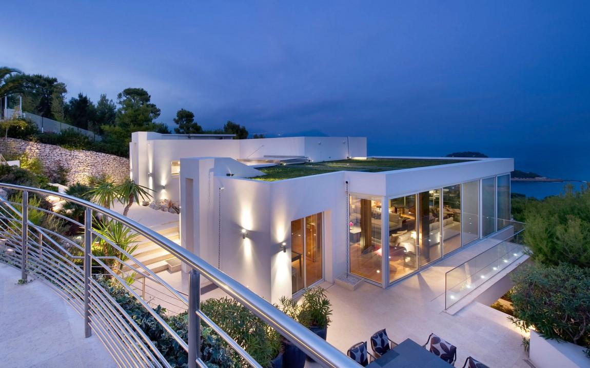 Modern home facade at night