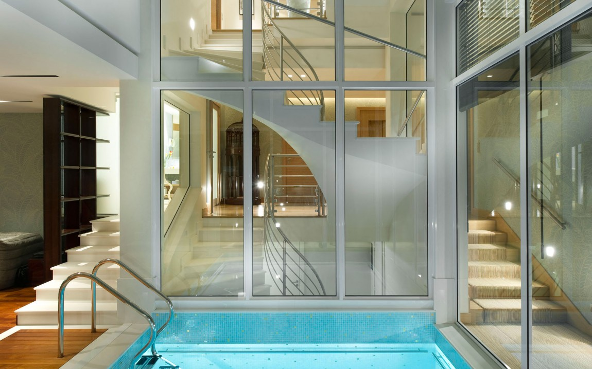 Indoor swimming pool and glass wall