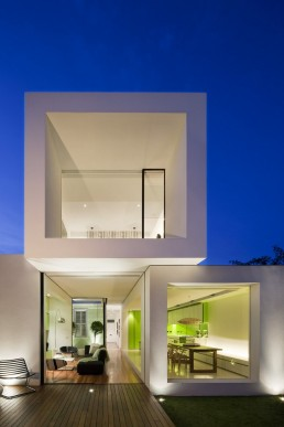 Facade of small minimalist home at night