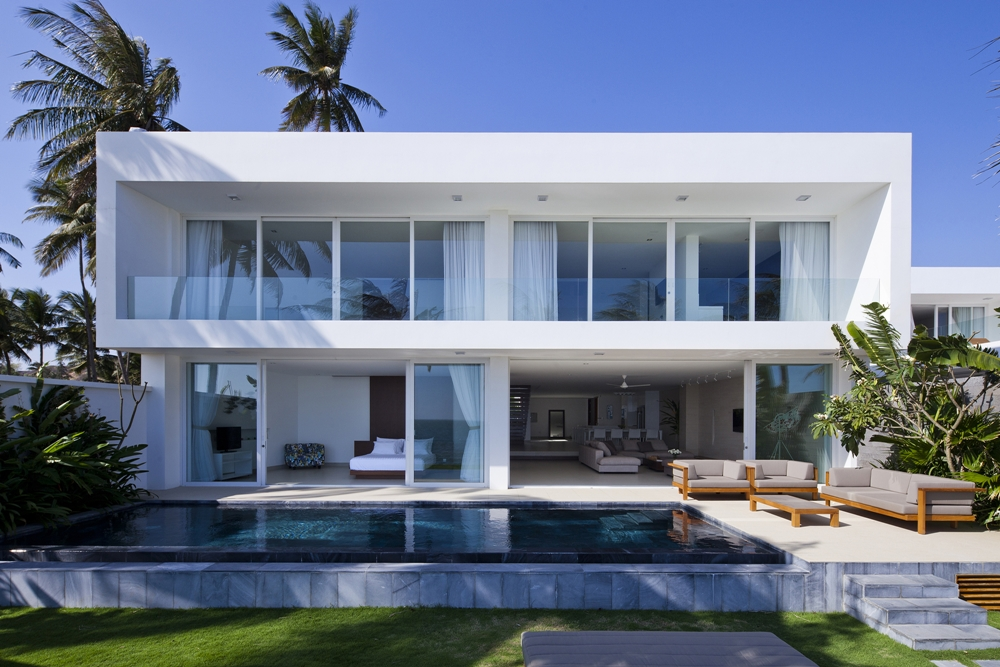 White Modern Facade On A Modern House Design