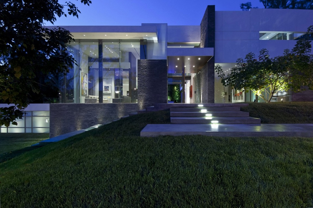 Modern Facade At Night. Elegant Luxury Modern Home