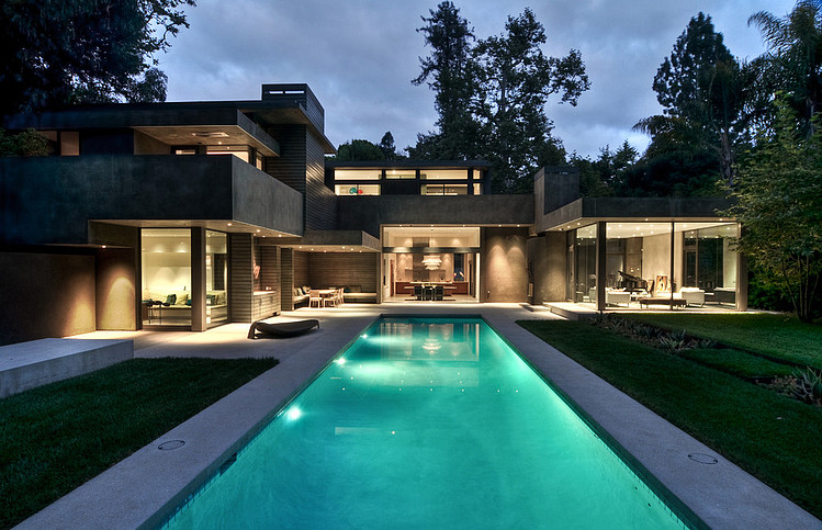 Amazing Home And Swimming Pool At Night. Small Modern Home
