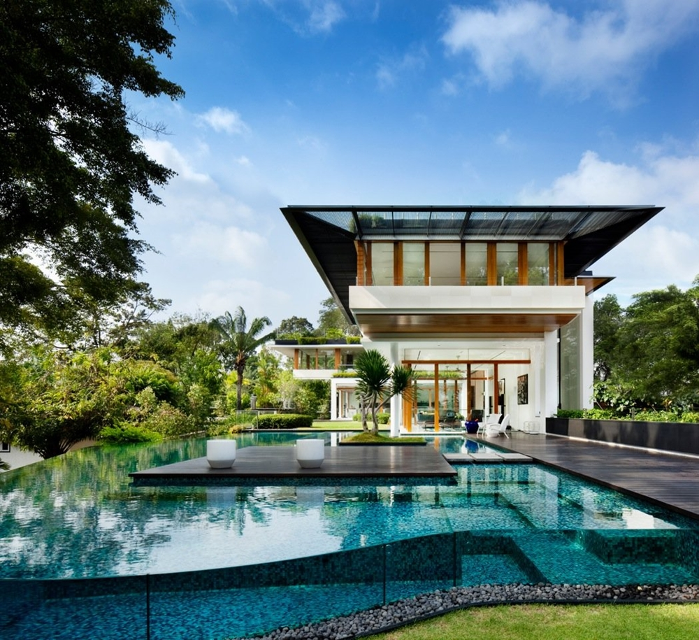 Tropical swimming pool and home. Futuristic modern home
