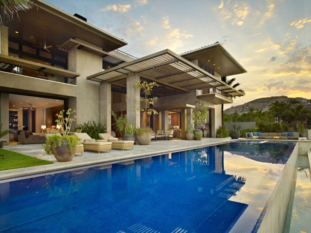 Large swimming pool and stone facade on modern home