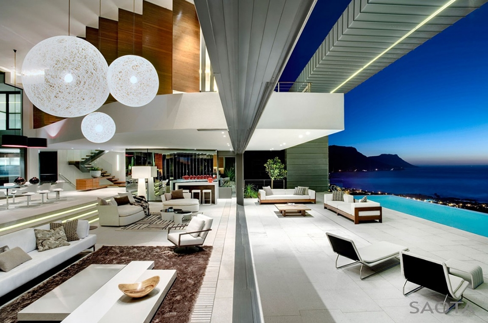 Interior and terrace designed by SAOTA. Modern glass facade. Minimalist  pavilion house
