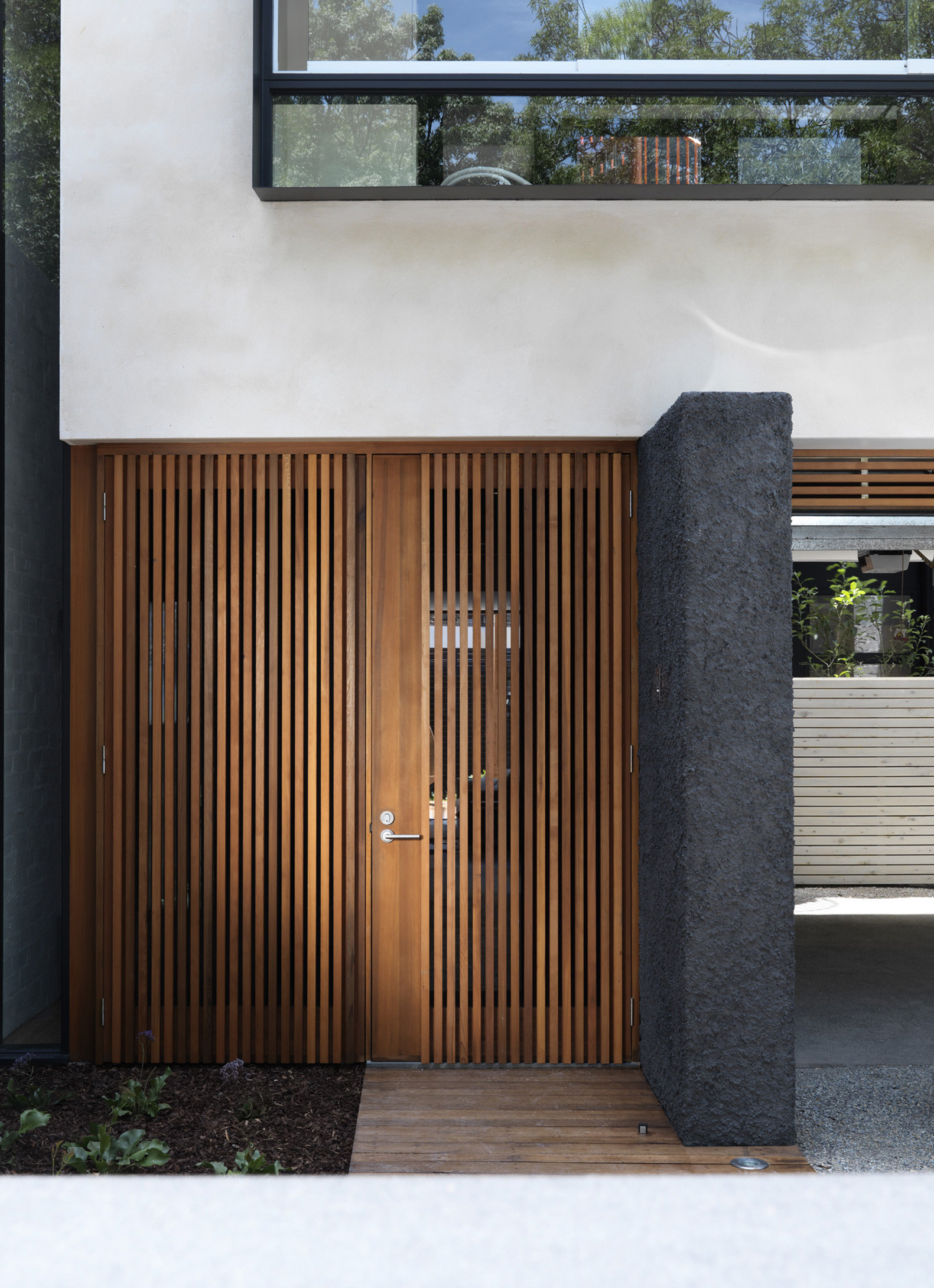 Door designs 40 modern doors perfect for every home for Home gate architecture