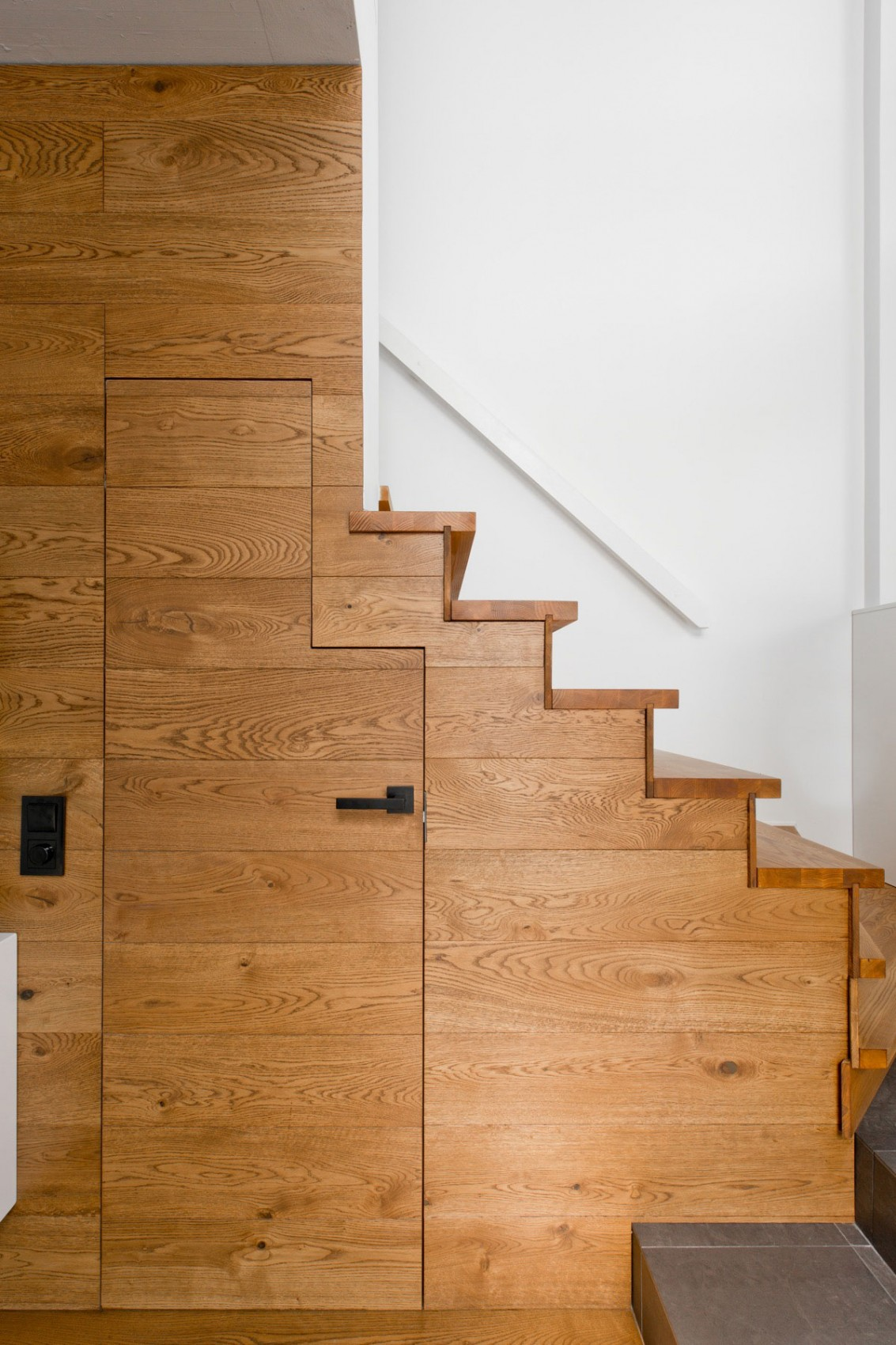 Storage under the staircase by InArch