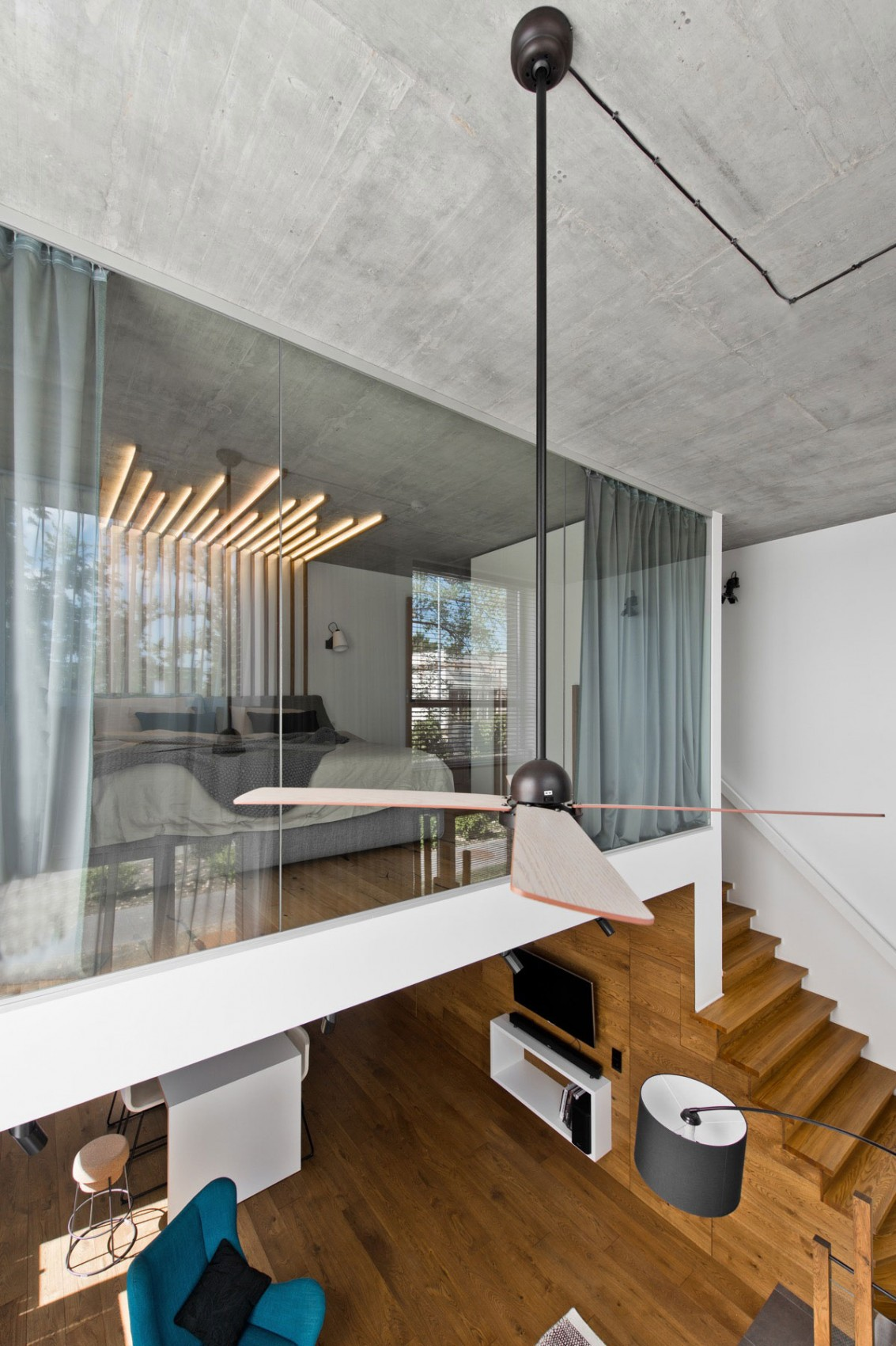 Bedroom glass wall by InArch