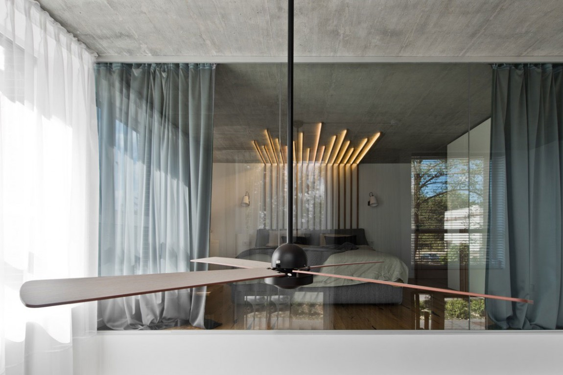 Ceiling fan and glass wall by InArch