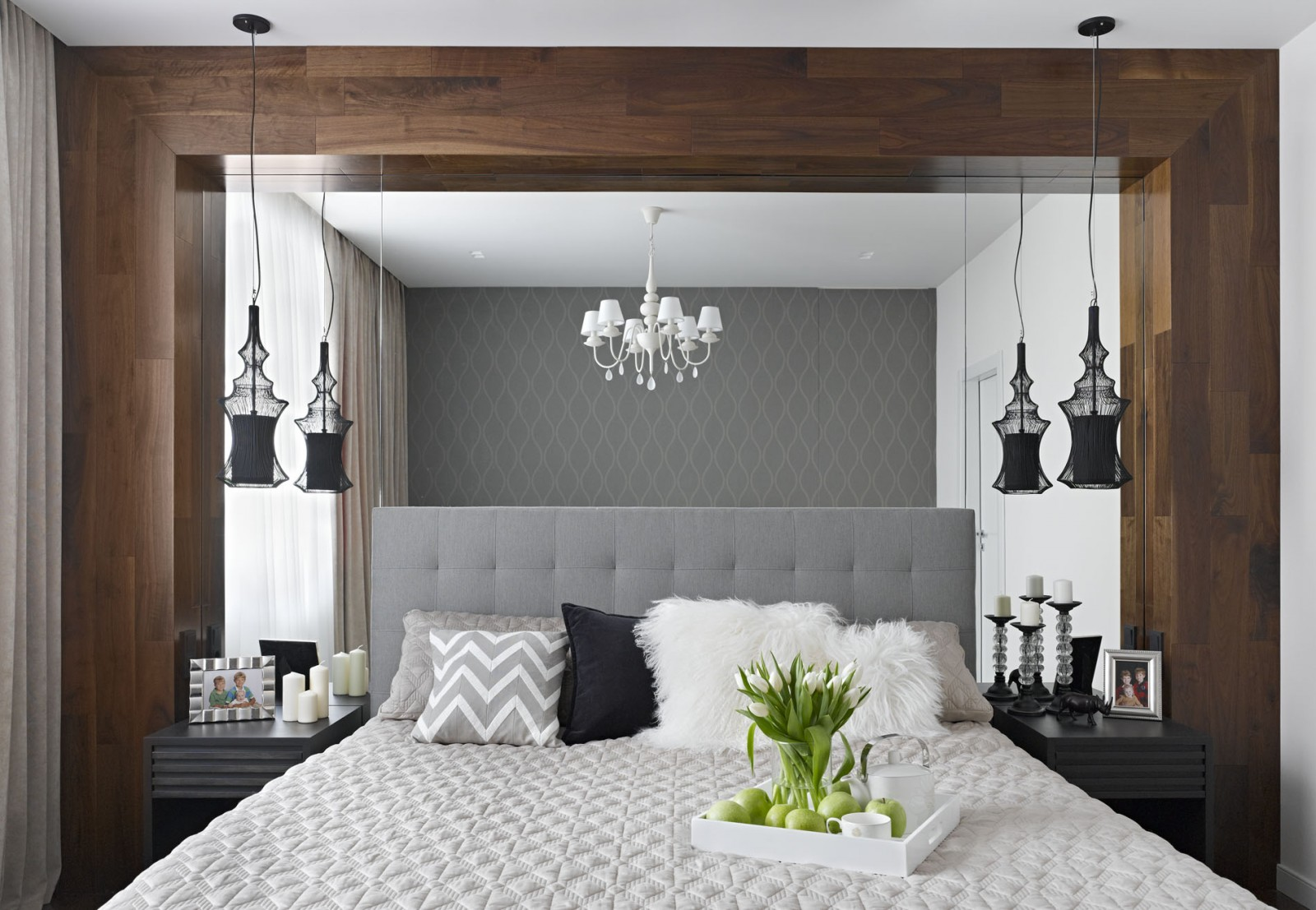 this bedroom shows how mirror can make small room look bigger and