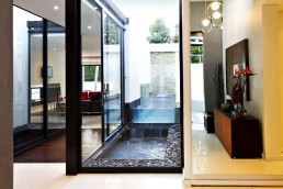 Glass walls in renovated Mosi residence by Nico van der Meulen Architects