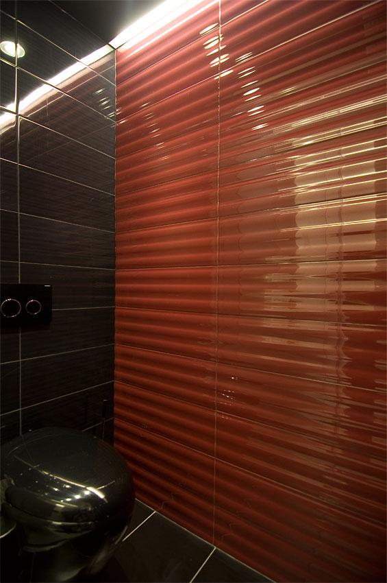 Red bathroom wall by Fimera