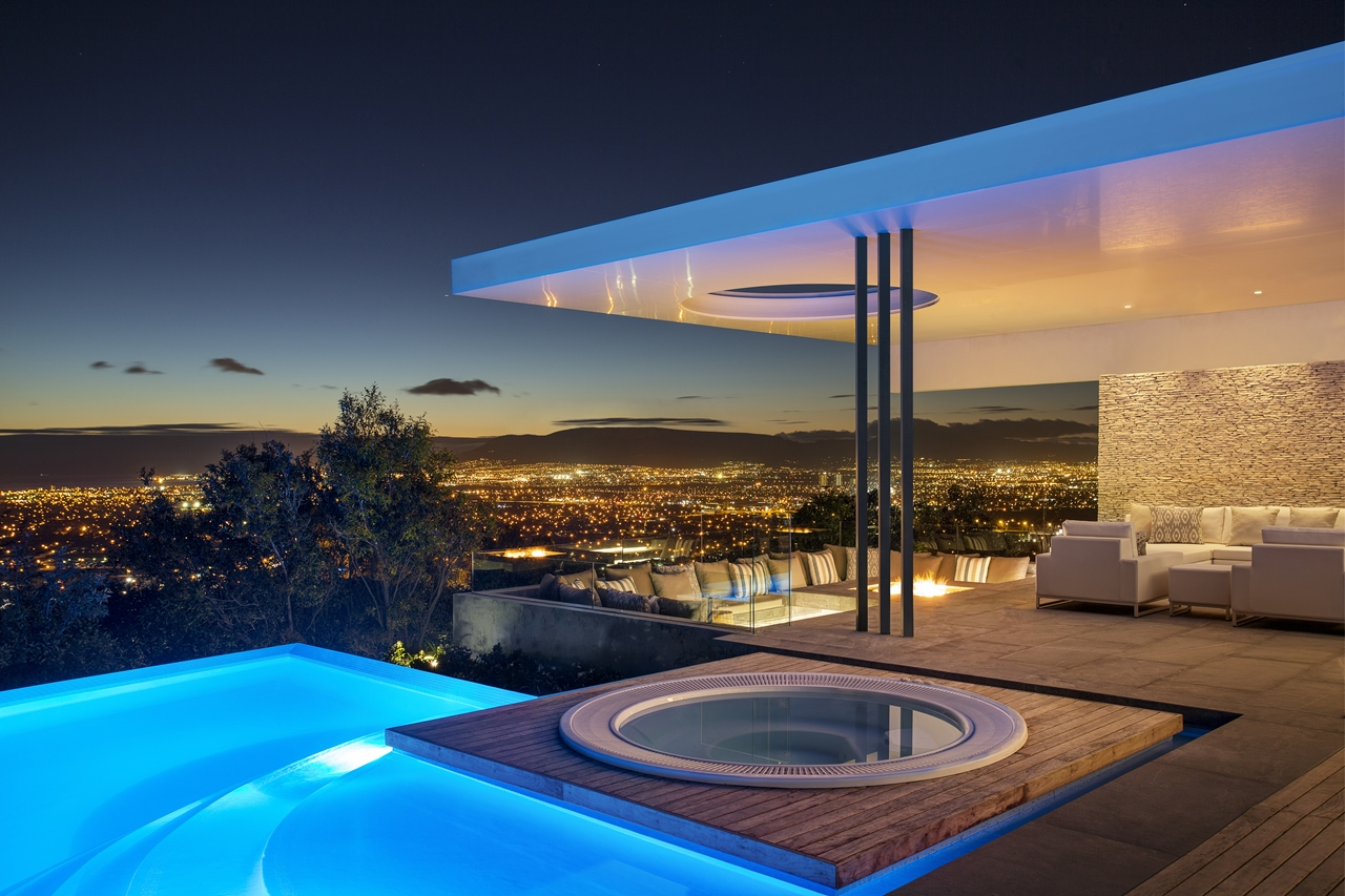 Night view from concrete and glass house