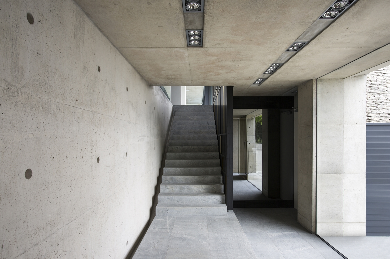 Staircase in the concrete and glass house