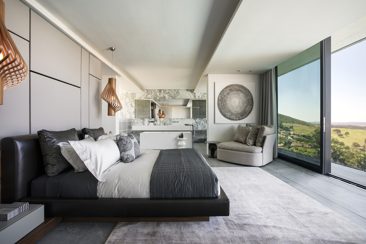 Modern bedroom in the concrete and glass house