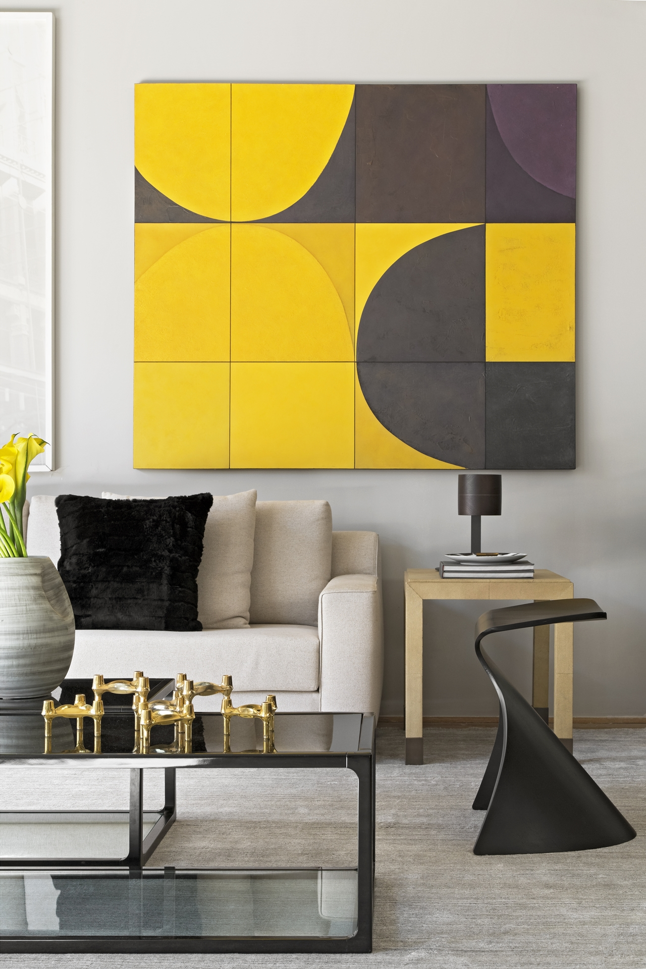 Yellow art piece in Itacolomi 445 apartment by Diego Revollo