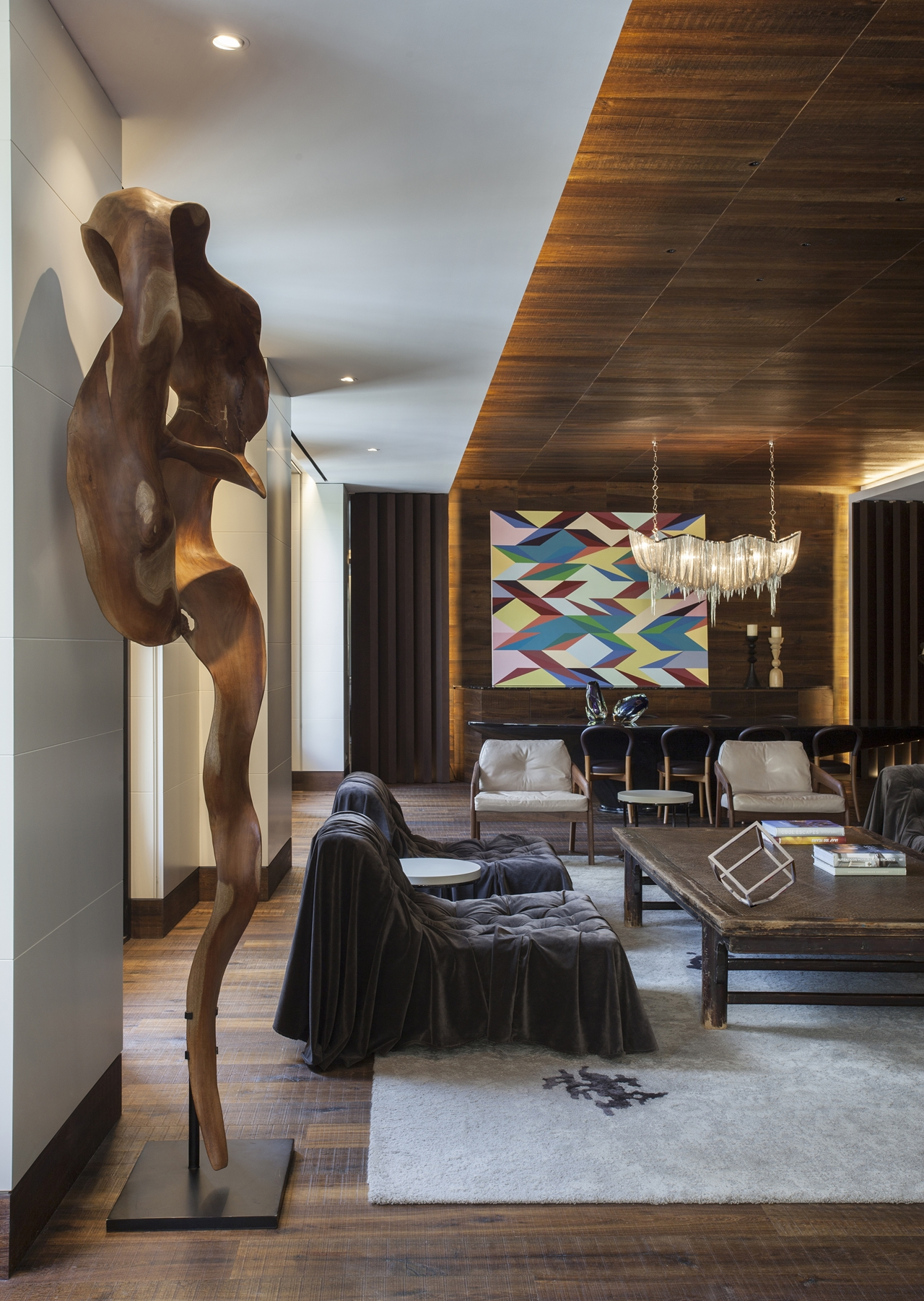 Wooden sculpture in interior design on Barcelona apartment by ARRCC