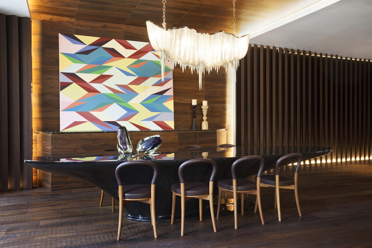 Dining room and wood in interior design in Barcelona apartment by ARRCC