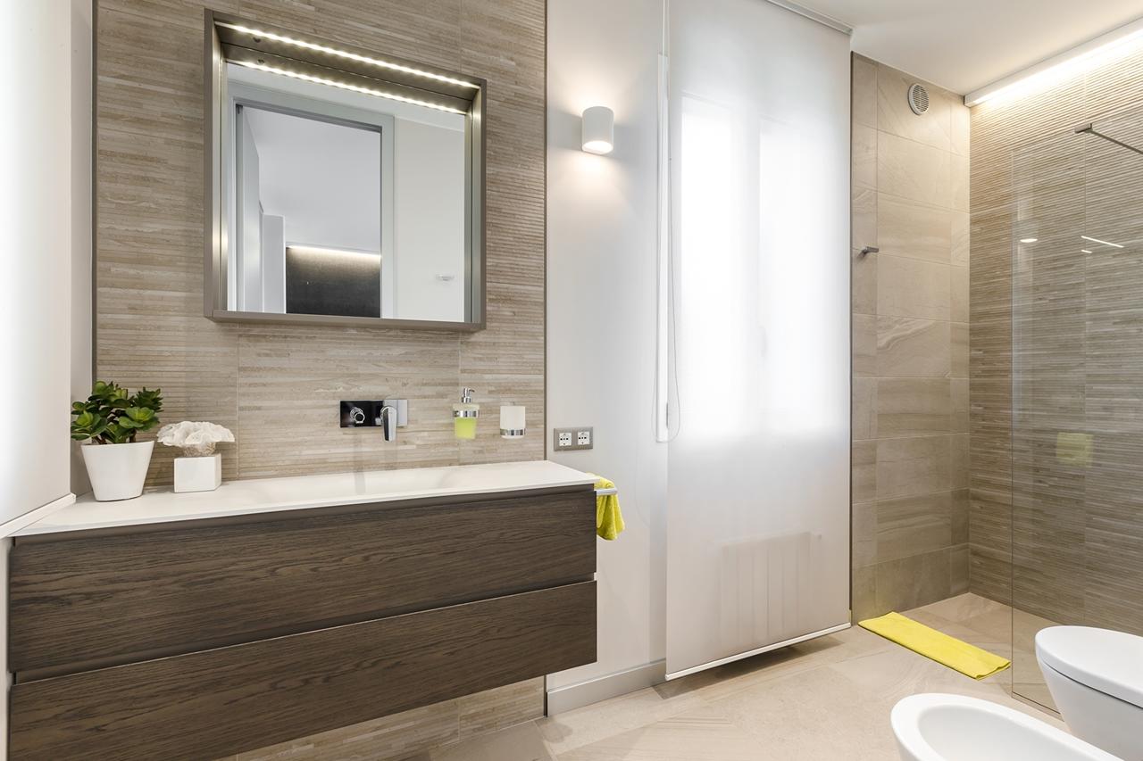 Brown modern bathroom design by NG Studio