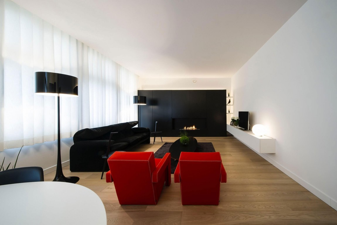 Living room in minimalist apartment by Filip Deslee