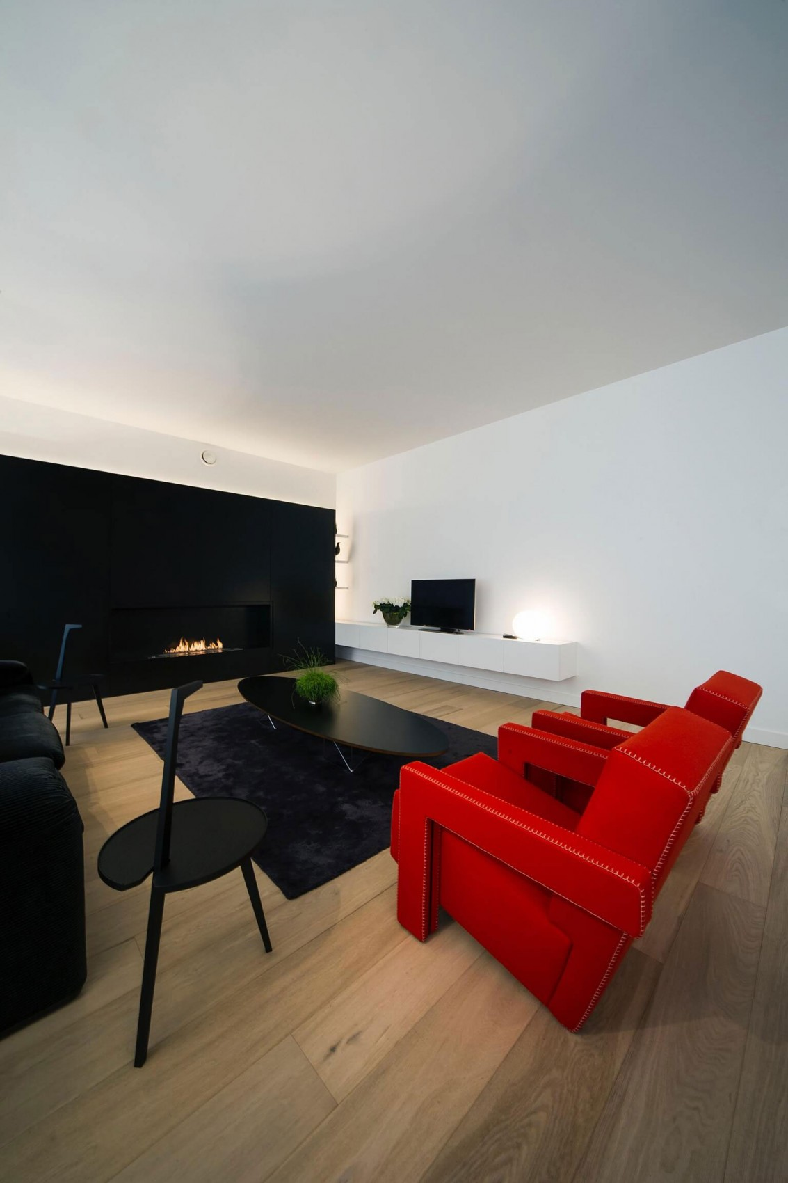 Bright living room in minimalist apartment by Filip Deslee