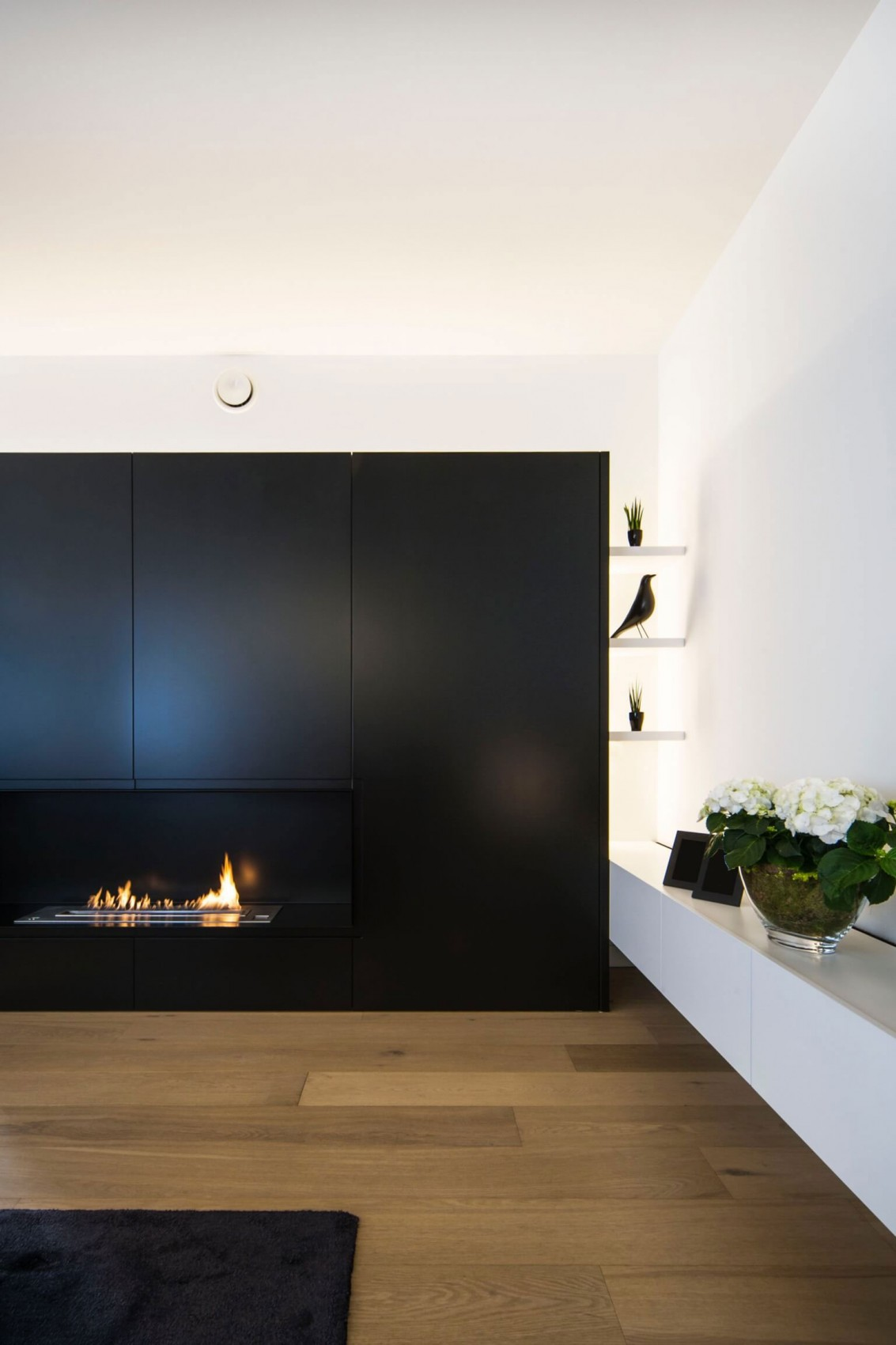 Black closet in minimalist apartment by Filip Deslee
