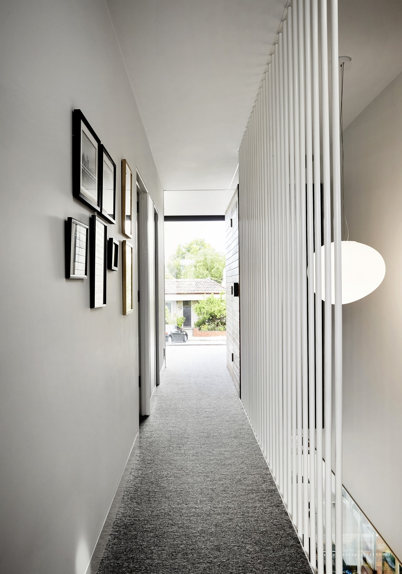 Narrow hallway by Austin Maynard Architects