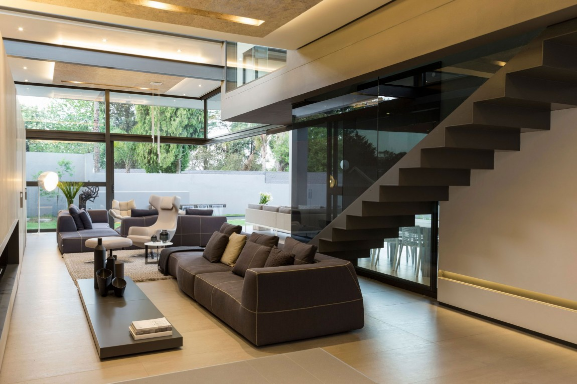 Living room and staircase in House Sar by Nico van der Meulen Architects