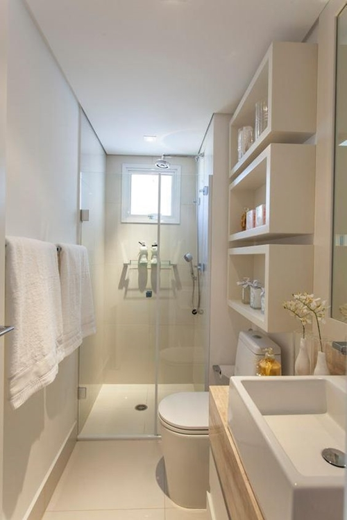 walk in shower in small bright bathroom
