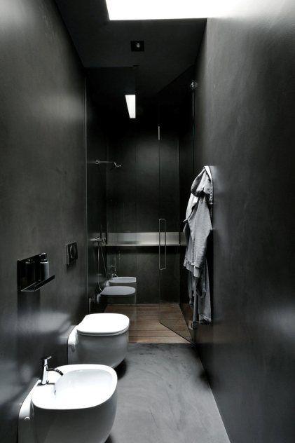walk in shower in small dark bathroom