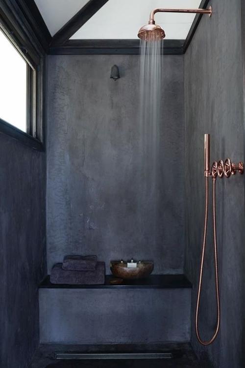 dark walk in shower with a seat