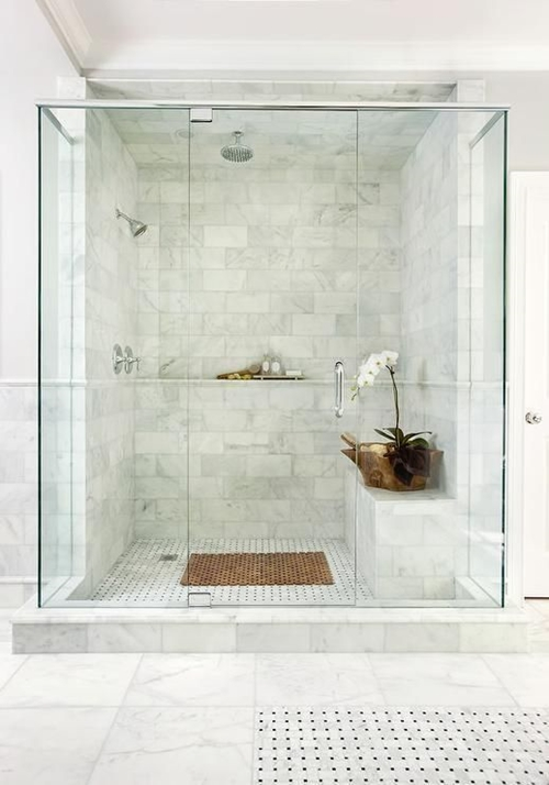 luxury walk in shower with a seat
