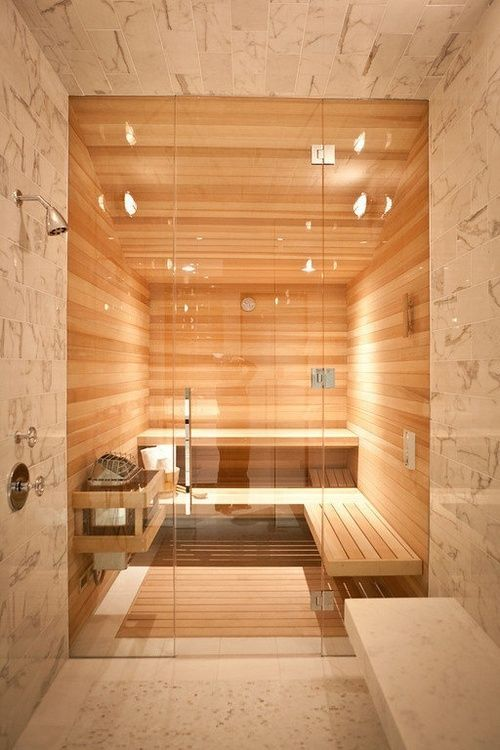 modern walk in shower with a seat and sauna
