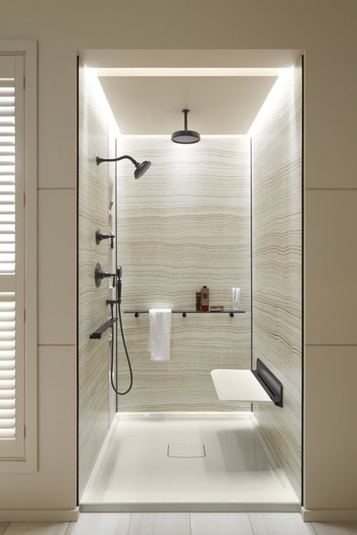 small modern walk in shower with a seat