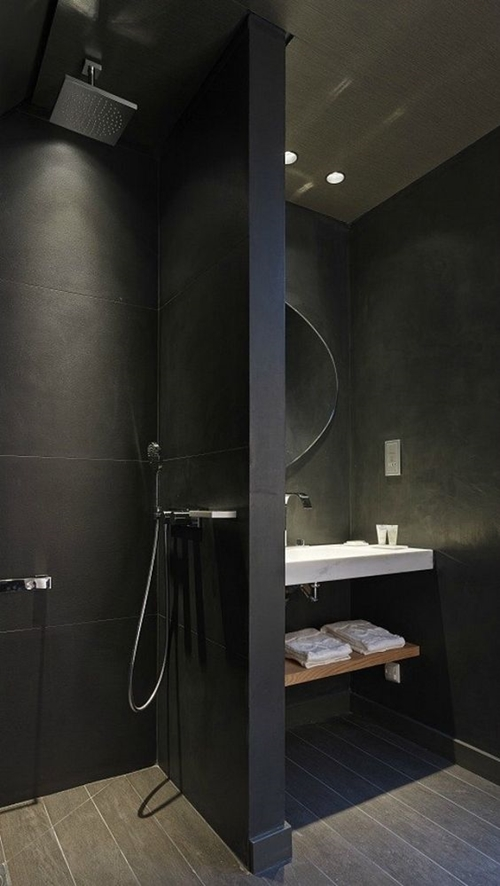 walk in shower without door in black bathroom