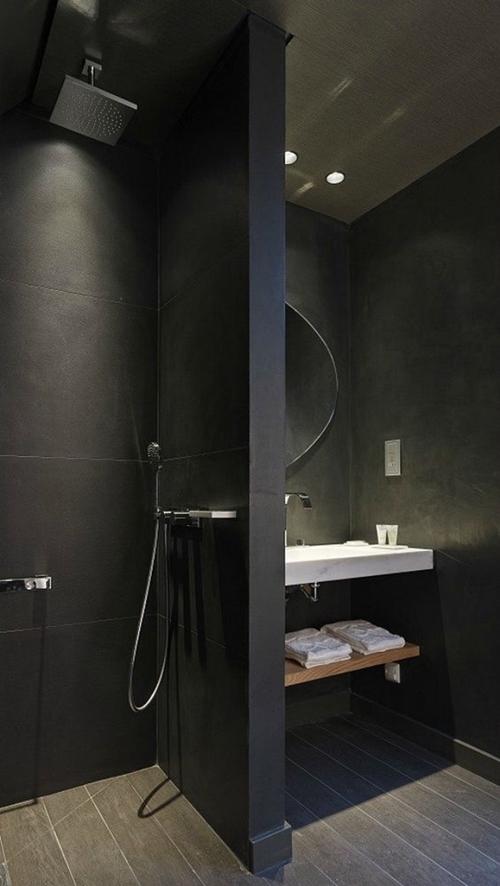 walk in shower without door in black bathroom
