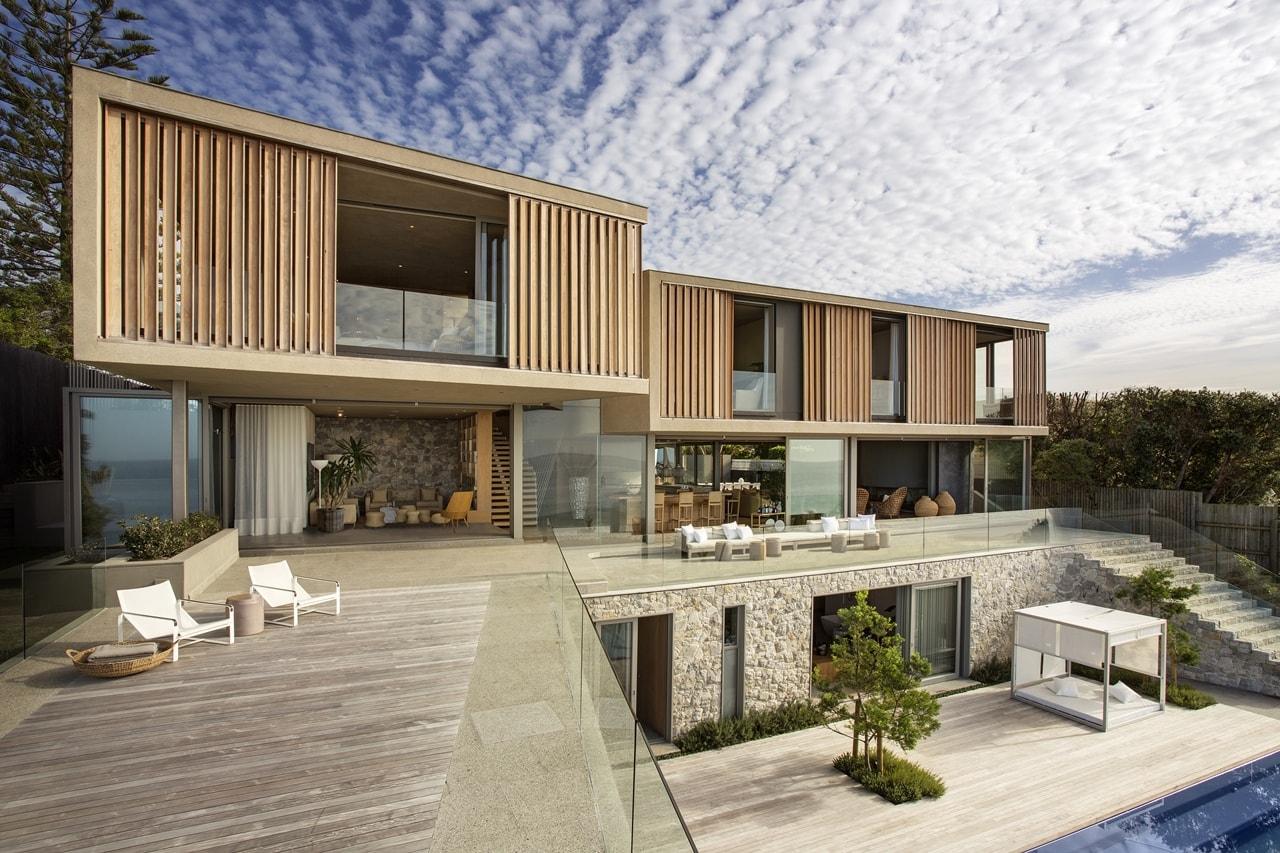 Wooden facade modern house design by saota architecture for Modern wood house