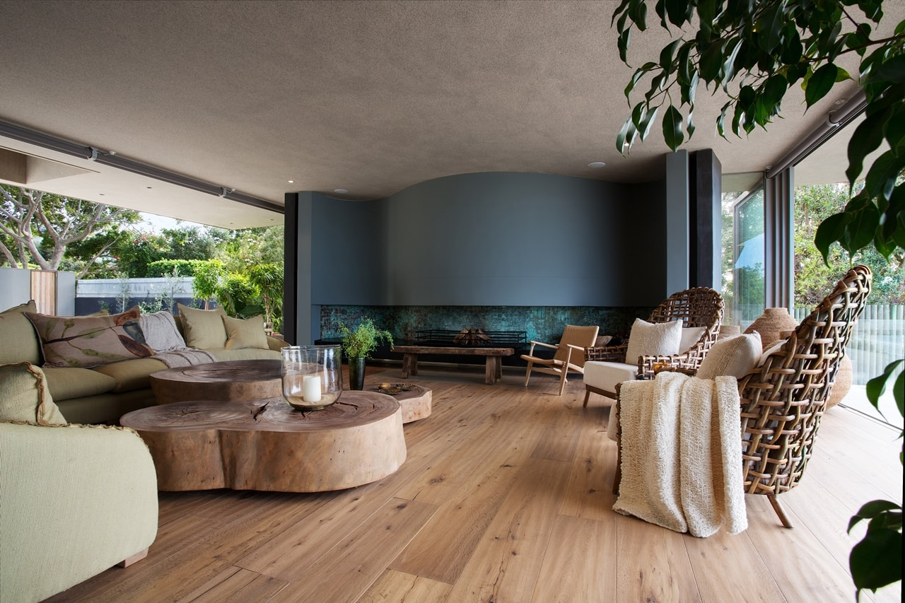 Amazing living room in modern home with wooden facade by SAOTA