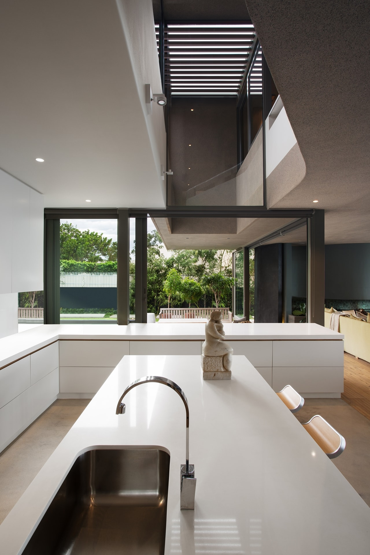 Modern kitchen in modern home with wooden facade by SAOTA