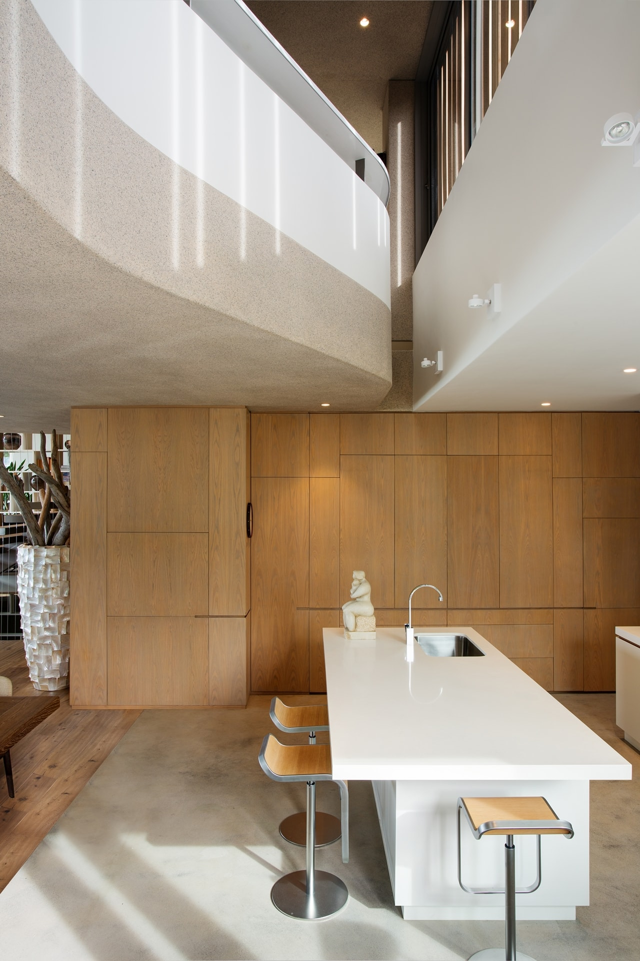 Furniture in modern home with wooden facade by SAOTA