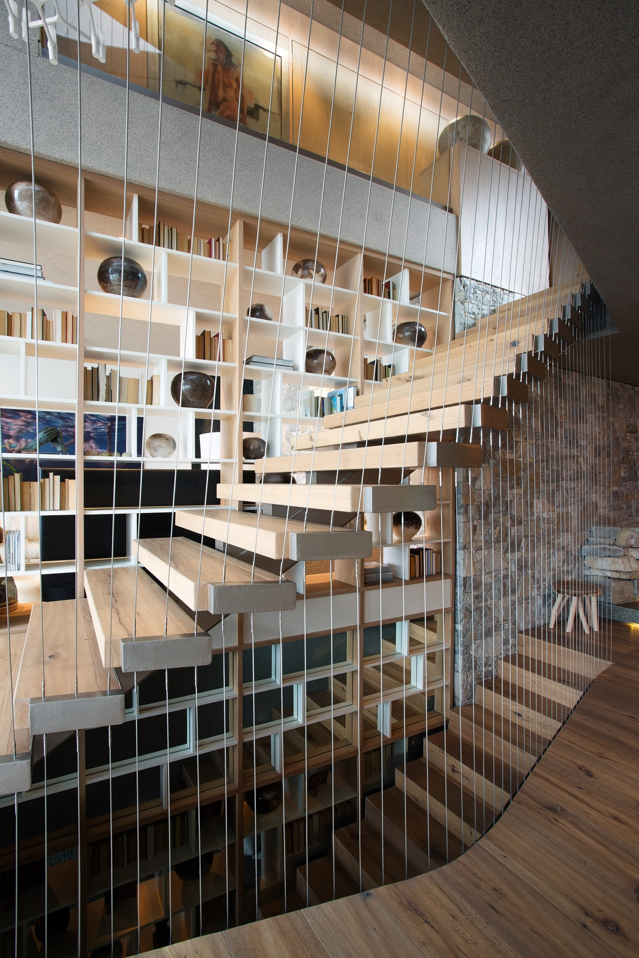 Staircase in modern home with wooden facade by SAOTA