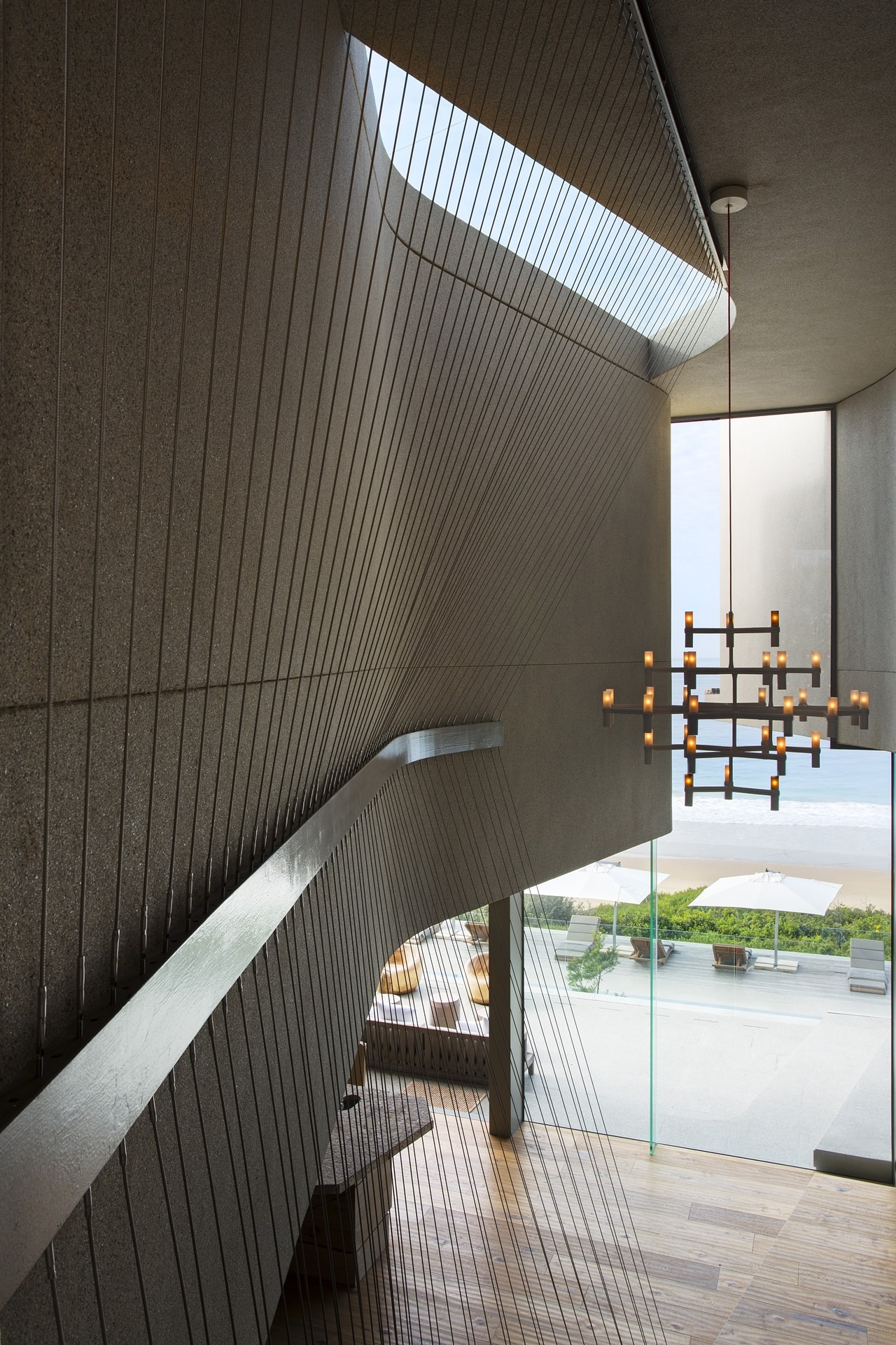 Staircase details in modern home with wooden facade by SAOTA