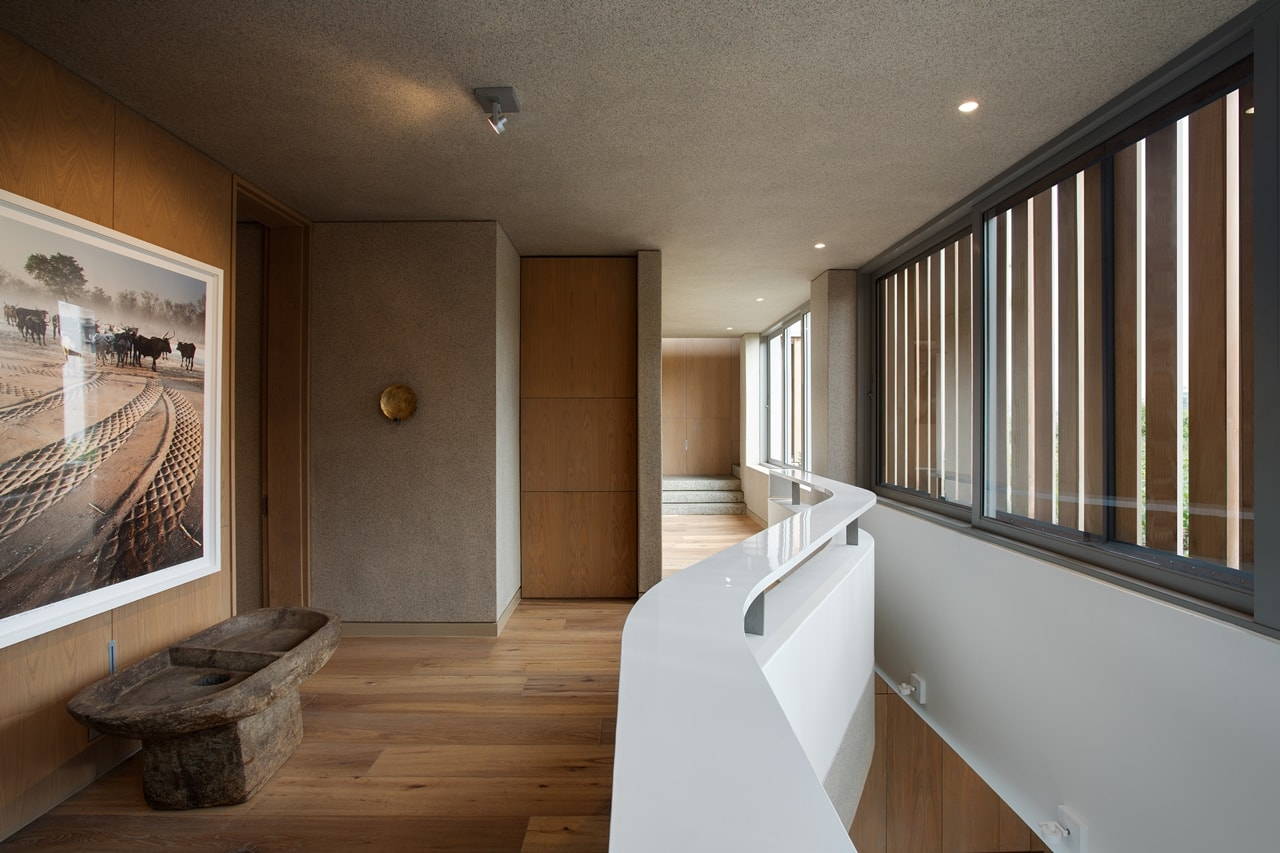 Hallway in modern home with wooden facade by SAOTA