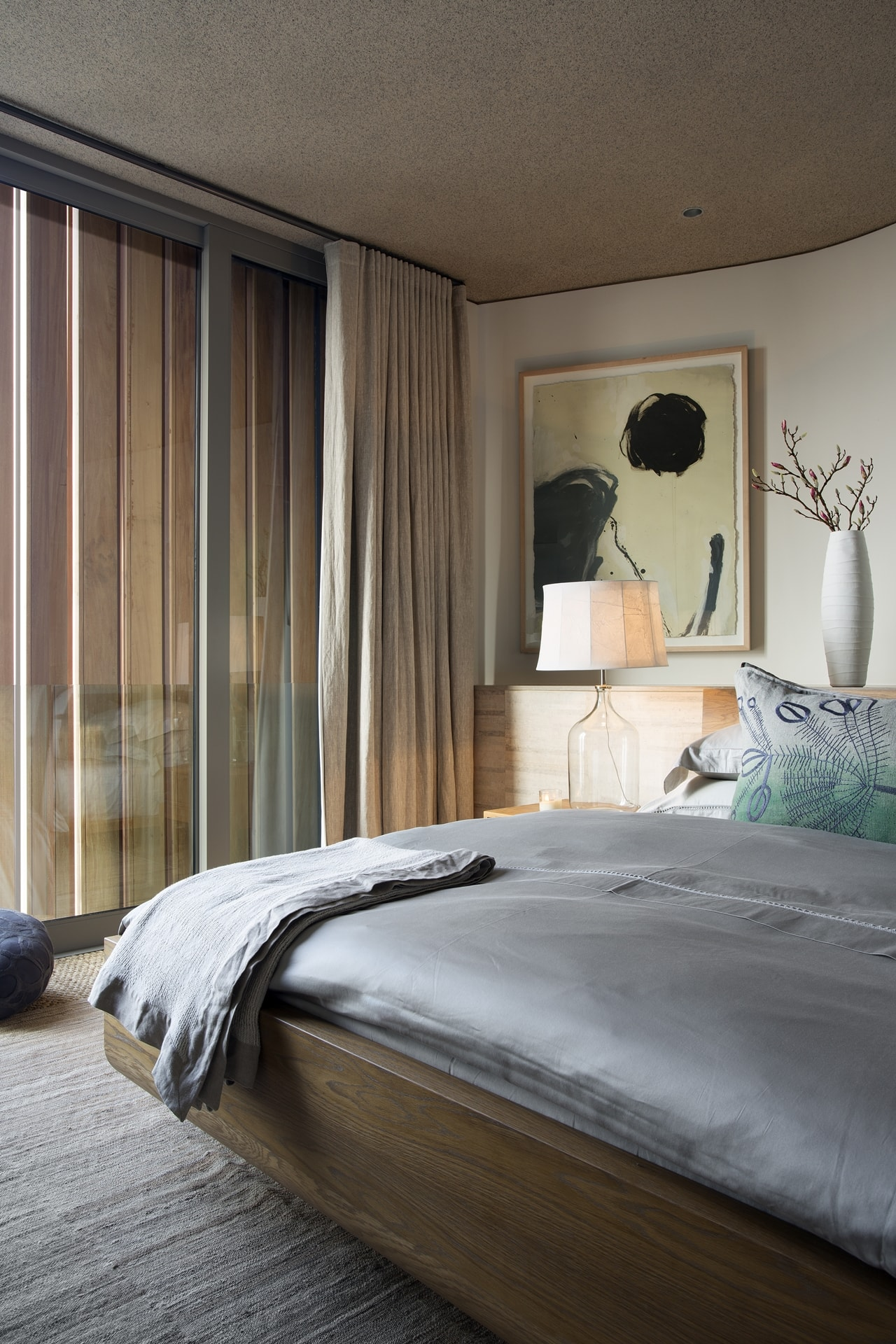 Modern bedroom furniture in modern home with wooden facade by SAOTA
