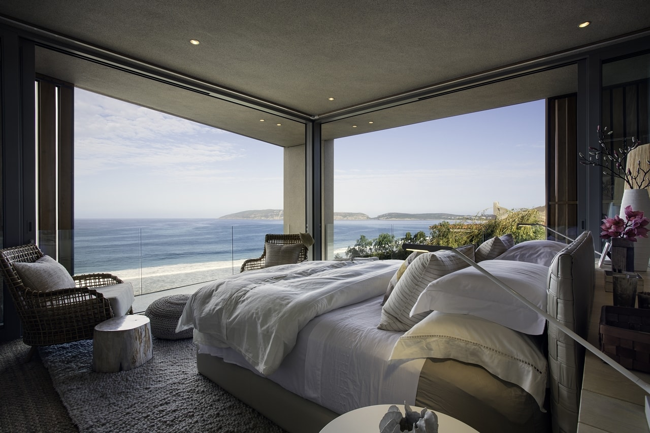 Amazing bedroom view in modern home with wooden facade by SAOTA