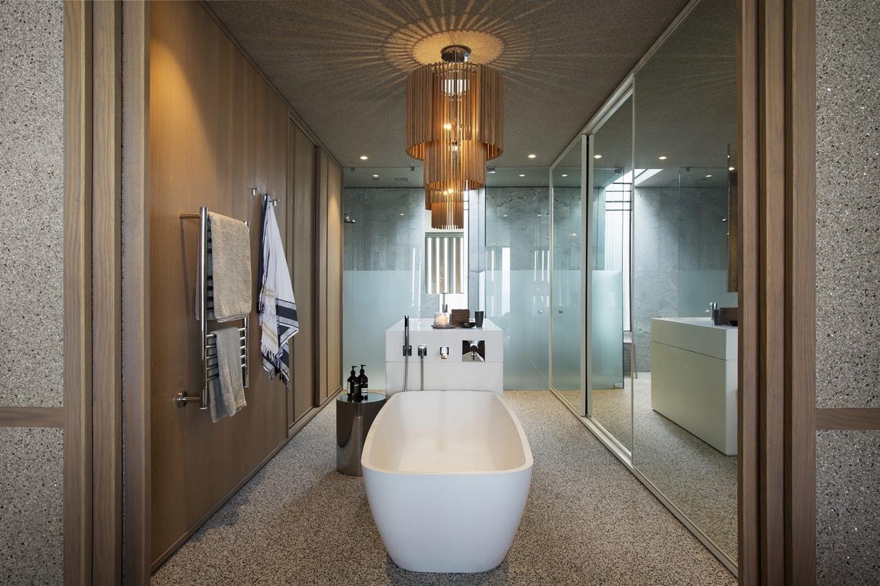 Secondary modern bathroom modern home with wooden facade by SAOTA